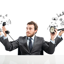 Businessman trying to juggle too many things